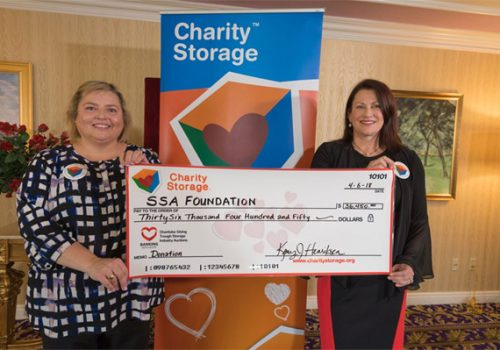 At the Spring 2018 ISS World Expo, Nancy Martin-Wagner, Chair of SSAF is presented with a check by Kerry Henriksen, Director of Charity Storage representing funds raised by Charity Storage for the Self Storage Association Foundation Scholarship Program.